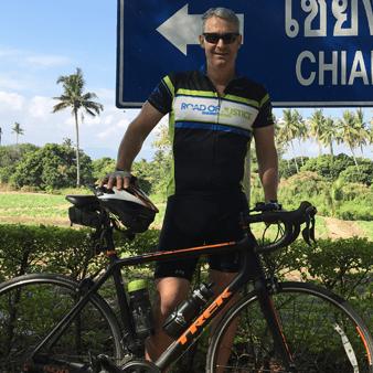 Brad Ortenzi standing next to his racing bike