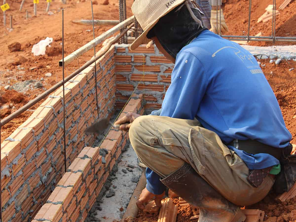 man laying brick