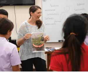 Children listening to a Woman team member teach