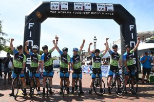 ZOE RAAM Team cyclists at the finish line winning first place