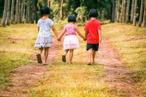three children holding hands